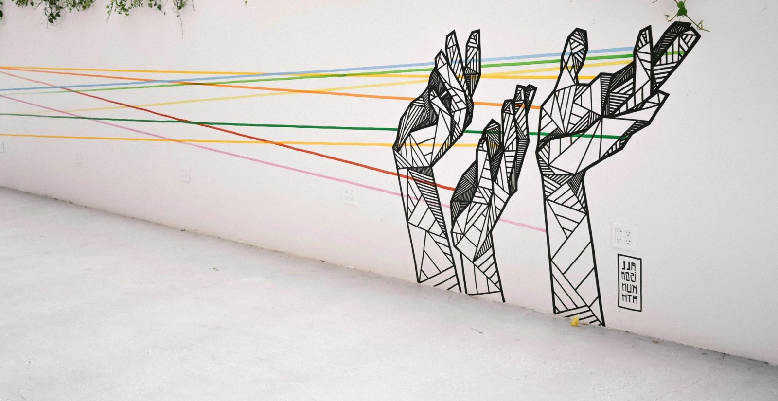 street art of geometric hands being connected
